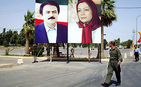 Supporters listen to Maryam Radjavi (on screen), president of the NCRI and Mujahedeen-e-Khalq (MEK) leader (AFP)