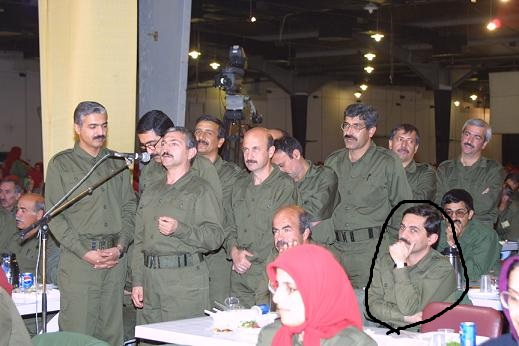 "Farid Totounchi (Real name:Mahoutchi) Commander of Saddam's Private army forcing Somayeh Mohammadi to do a ""Forced confession"" session in Terror camp in Albania"